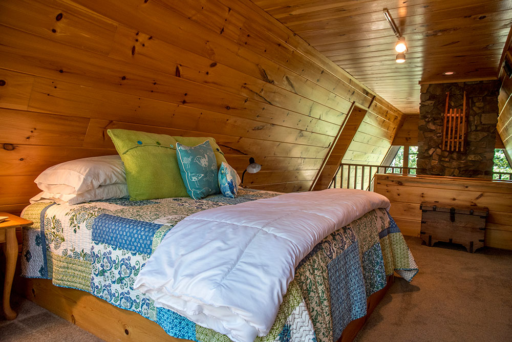 Sunrise Cabin Rental Master Bedroom at Peckerwood Knob Cabins in Oklahoma
