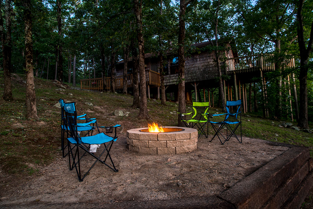 Relax outside your Kiamichi Mountain Sunset Cabin Rental at Peckerwood Knob Cabins in Oklahoma