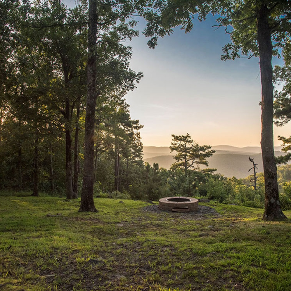 The Kiamichi Mountains greet you from your mountain cabin rental deck view at Peckerwood Knob Cabins in Oklahoma