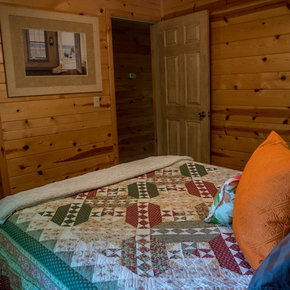 Sunset Cabin Bedroom at Peckerwood Knob Cabins in Oklahoma