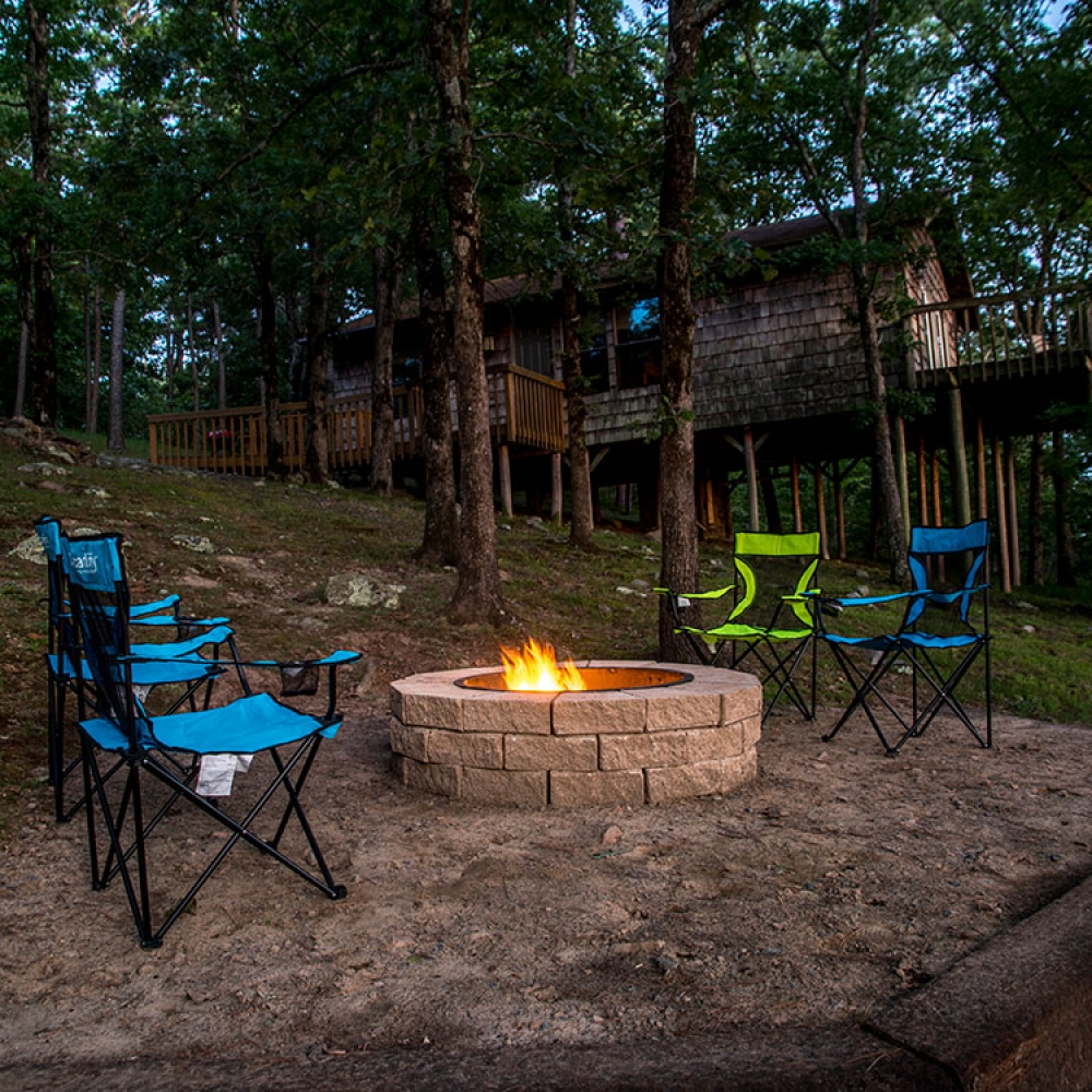 Relax at the firepit outside your Sunset Cabin rental at Peckerwood Knob Cabins in Oklahoma