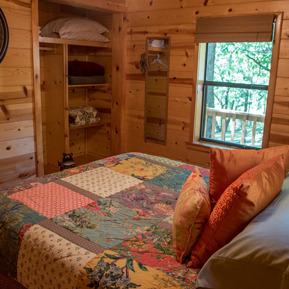 The Sunset Cabin Rental Bedroom at Peckerwood Knob Cabins in Oklahoma