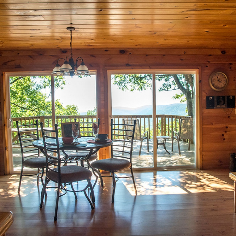 The Sunset Cabin Rental Dining Area overlooking the Kiamichi Mountains at Peckerwood Knob Cabins in Oklahoma